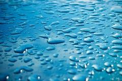 Raindrops on car stock image
