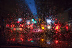 Raindrops on car glass. At night Royalty Free Stock Photos