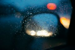 Raindrops on the car rearview mirror. stock photos