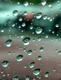 Raindrops on Car Window. Close-up of raindrops inside car looking out Royalty Free Stock Images