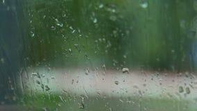 Raindrops on car window stock video footage