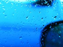 Raindrops on car window up royalty free stock photos