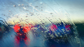 Raindrops on a car windscreen Stock Images