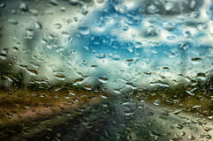 Raindrops on car windshield. Raindrops water drops on car windshield Royalty Free Stock Photo