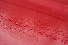 Raindrops on ceramic coated red car with hydrophobic effect stock photos