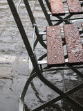 Raindrops on chairs. Chairs standing in the rain royalty free stock image