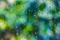 Raindrops on clear glass window after raining Stock Image