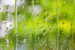 Raindrops on clear glass window after raining Royalty Free Stock Image