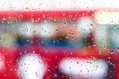 Raindrops on double decker bus Stock Photos
