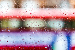Raindrops on double decker bus Royalty Free Stock Images
