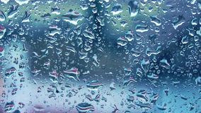 Raindrops falling on glass stock footage
