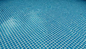 Raindrops falling in pool stock video footage