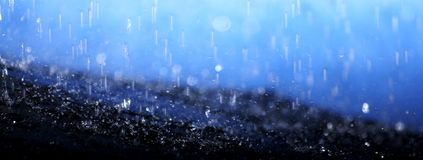 Raindrops falling on an umbrella Stock Photo