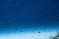 Raindrops on glass, abstract background Stock Photos