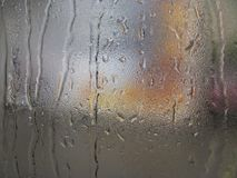 Raindrops on the glass in the autumn day stock image