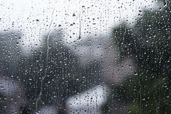 Raindrops on a glass Stock Images