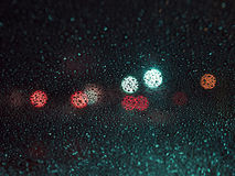 Raindrops on the glass on blur background of colored spots Stock Photos