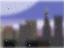 Raindrops on glass. A city outside the window Royalty Free Stock Photos