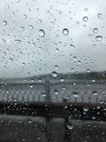 Raindrops on the glass in the foreground. Figured fence of the b royalty free stock images