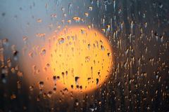 Raindrops on glass Stock Images