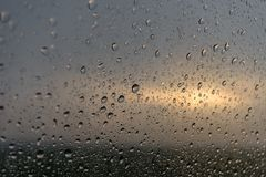 The raindrops on glass of a window stock photo