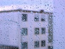 Raindrops on glass window with building view Royalty Free Stock Photos