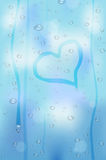 Raindrops on glass window - heart shape Stock Photo