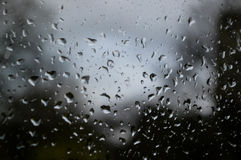 Raindrops on glass. Raindrops on a window overlooking a park Stock Photography
