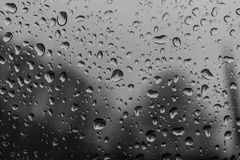 The raindrops on glass of a window royalty free stock photos