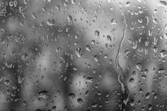 The raindrops on glass of a window stock photos