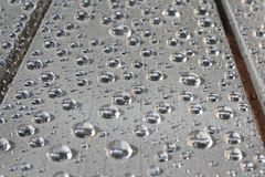 Raindrops on grey table Royalty Free Stock Photo