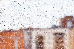 Raindrops on home glass window Stock Photo
