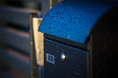 Raindrops on mailbox Stock Photo