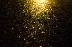 Raindrops on metal. With a light shining on it Royalty Free Stock Photography