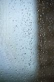 Raindrops on a mosquito net. Mosquito net on a window with a curtain. Vertical background