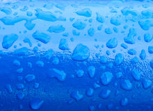 Raindrops on a painted  surface Stock Photography