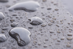 Raindrops pattern on wooden deck close up Stock Image