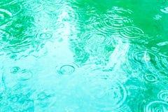 Raindrops on a puddle. Rainy day. stock photos