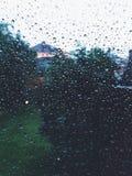 Raindrops. Rainy day from indoors stock image
