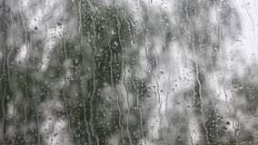 Raindrops running down a window. stock video footage