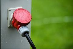 Raindrops are seen on industrial electric plug during rain. Raindrops are seen on industrial electric plug during heavy rain stock image