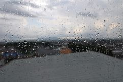 Raindrops that stick to the glass stock images