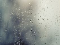 Raindrops on the surface of window glass with stock images