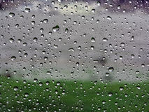 Raindrops on vehicle window Stock Photos