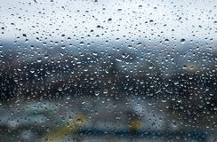Raindrops or water droplets on a glass window Royalty Free Stock Photography