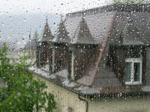 Raindrops on the window. Old house through raindrops on the window Royalty Free Stock Images
