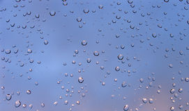 Raindrops on a window. Looking through a rain-spattered window stock image