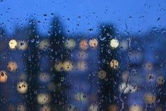 Raindrops on the window. The autumn rain, raindrops evening at dusk Stock Photo