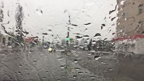 Raindrops on the window of car movement. movement of rain fall stock footage
