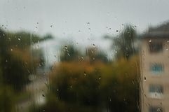 Raindrops on the window glass. In city Royalty Free Stock Image